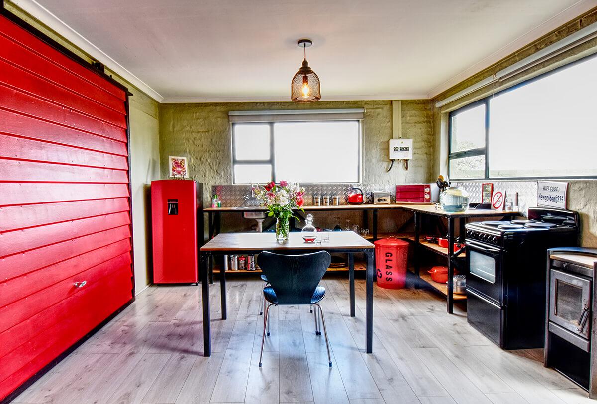 Rustic Red Studio with its unique garage door decor