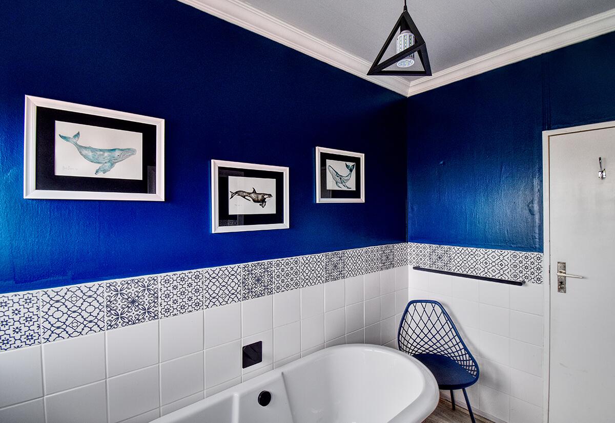 Bathroom with bath and decor